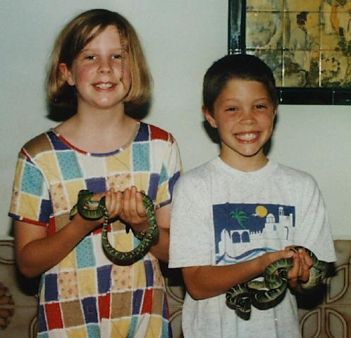 Children holding venomous Wagler's Vipers at Snake Temple.
