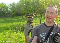 Jamison with an unruly Black Rat Snake.