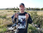 Shaun with a pair of California King Snakes.
